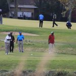 Golfers preparing to tee off at a men's golf league.