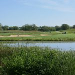 Golfers playing on a perfect summer day.