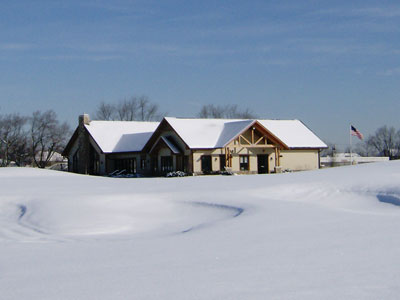 Coyote Run's clubhouse in winter snow.